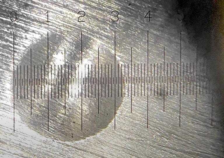 Black graticule on high key surface